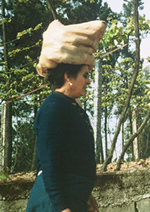 woman carrying potatoes
